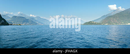 Lake Como (Italy) view from ship (summer panorama) - Stock Photo
