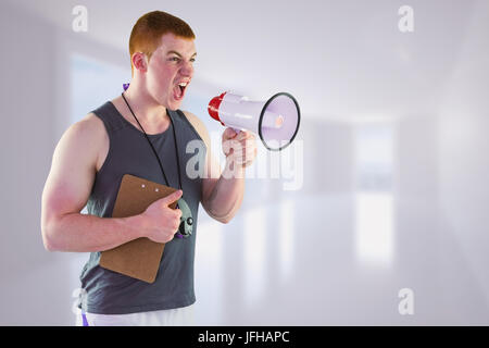 Composite image of angry personal trainer yelling through megaphone - Stock Photo