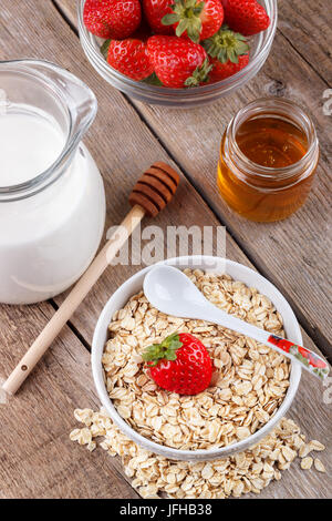 Healthy cereal with milk, honey and strawberry - Stock Photo