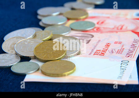 Singaporean notes and coins - Stock Photo