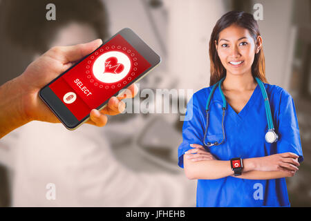 Composite image of asian nurse with stethoscope crossing arms - Stock Photo