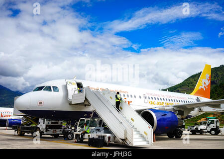 Thimphu, Bhutan - Aug 29, 2015. Airplanes docking at Paro Airport in Thimphu, Bhutan. Bhutan is a landlocked country - Stock Photo
