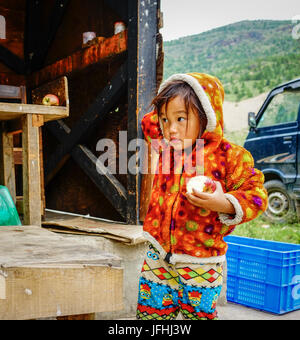 Thimphu, Bhutan - Aug 29, 2015. A Tibetan girl playing at the local market in Thimphu, Bhutan. Bhutan ranks first - Stock Photo