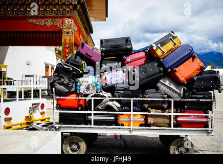 Thimphu, Bhutan - Aug 29, 2015. Loading luggages at Paro Airport in Thimphu, Bhutan. Thimphu is the political and - Stock Photo