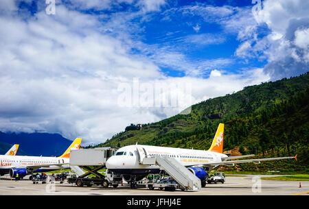 Thimphu, Bhutan - Aug 29, 2015. Airplanes docking at Paro Airport in Thimphu, Bhutan. Thimphu is the political and - Stock Photo