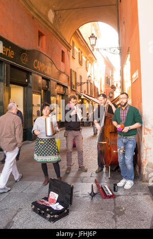 Bologna, Italy - April 22, 2017: Buskers playingand singing in Piazza Maggiore of Bologna - Stock Photo