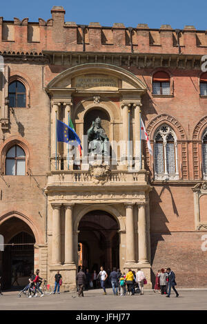 Bologna, Italy - April 22, 2017: Door of Palace of Accursio in Piazza Maggiore of Bologna with tourists on a sunny - Stock Photo