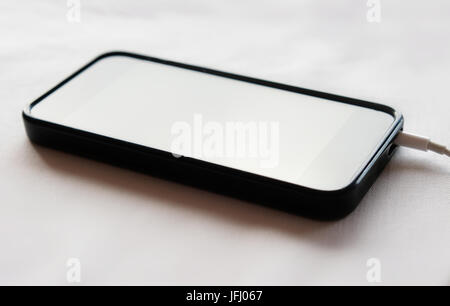 black mobile phone / smart phone charging - Stock Photo