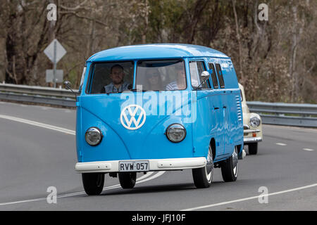 Vintage 1959 Volkswagen Kombi Van driving on country roads near the town of Birdwood, South Australia. - Stock Photo