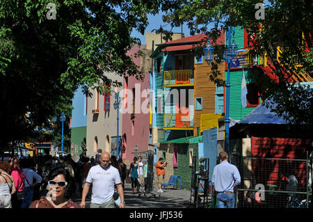 South America, Argentina, Buenos Aires, part of town La Boca, street scene, passer-by, coloured house facades - Stock Photo