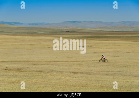 Mongolia, Central Asia, Biker between Tsenkher and Khotont - Stock Photo