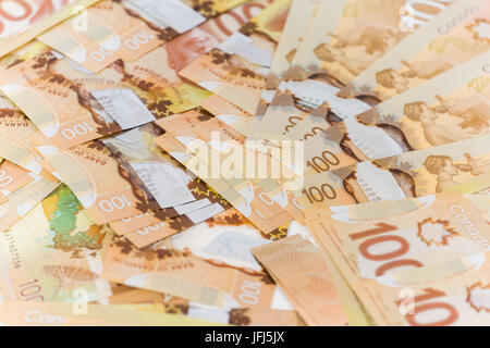 Background made up of Canadian banknotes - Stock Photo