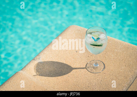 Gin tonic in the pool - Stock Photo
