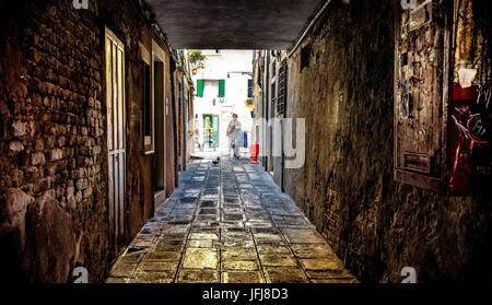 Narrow lane in Old Town, Venice, Veneto, Italy