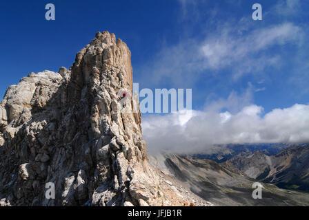 Alta Badia, Dolomites, South Tyrol, Italy, Climber on the via ferrata of the Cima Dieci / Zehnerspitze in the Dolomites - Stock Photo