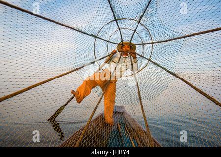 Inle lake, Nyaungshwe, Shan state, Myanmar, Fisherman looking through the fishing net, - Stock Photo