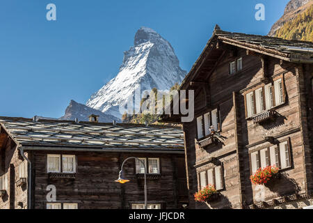 Traditional houses in the village of Zermatt with Matterhorn in the background, Valais, Switzerland Europe - Stock Photo