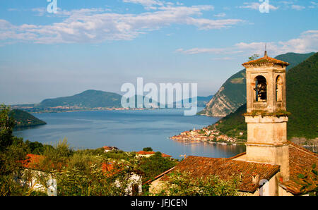 Europe, Italy, Lombardy, Iseo lake in Lombardy with the bell tower in the south side of lake - Stock Photo