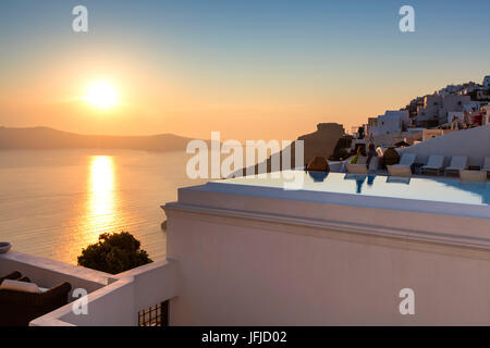 Sunset over the Aegean Sea seen from the old village of Firostefani Santorini Cyclades Greece Europe - Stock Photo