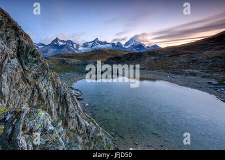 View of Weisshorn from Lake Stellisee at dawn Zermatt Pennine Alps Canton of Valais Switzerland Europe - Stock Photo