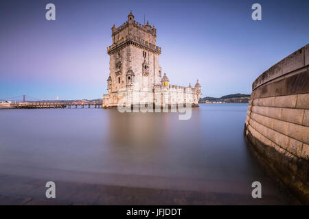 The colorful dusk on the Tower of Belém reflected in Tagus River Padrão dos Descobrimentos Lisbon Portugal Europe - Stock Photo