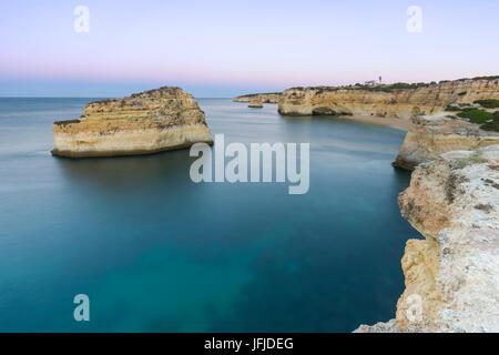 Top View of cliffs and turquoise water of Praia De Albandeira Carvoeiro Caramujeira Lagoa Municipality Algarve Portugal - Stock Photo