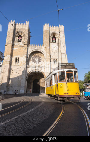 The yellow tram number 28 close to the ancient cathedral of Alfama district Lisbon Portugal Europe - Stock Photo