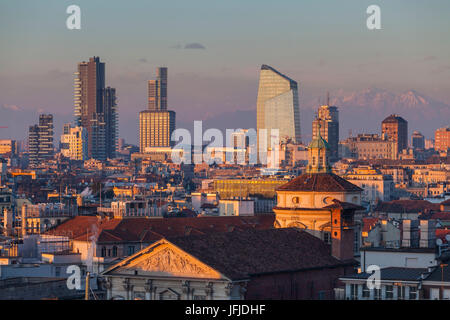 Milan, Lombardy, Italy, The skyscrapers of Milan city at sunset seen from the Cathedral - Stock Photo