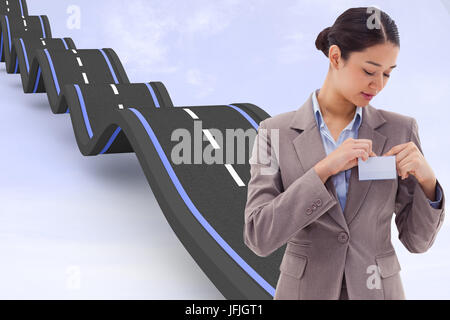 Composite image of portrait of a businesswoman clipping her badge - Stock Photo