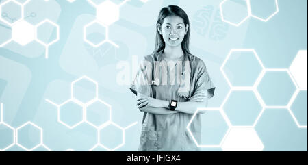 Composite image of asian nurse with arms crossed - Stock Photo