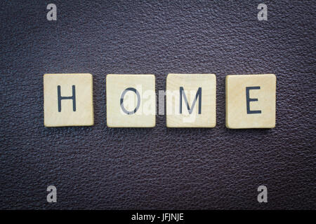 Home word concept - overhead photo wood on leather - Stock Photo