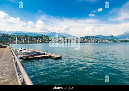 Lugano city, lake Lugano, Switzerland. View of the gulf of Lugano on a beautiful summer day - Stock Photo