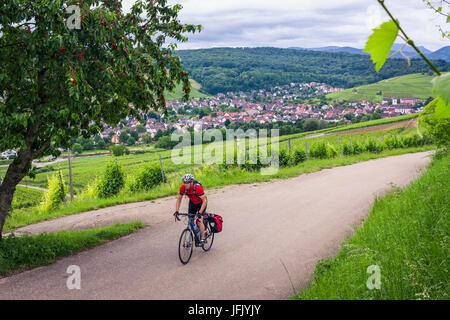 Man on solo bicycle road trip - Stock Photo