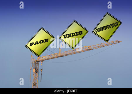 Construction Crane that says Page Under Construction - Stock Photo