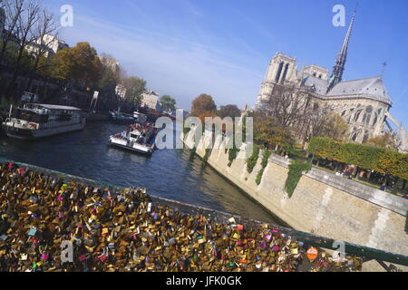 Love Locks and Notre Dame in Paris,France - Stock Photo