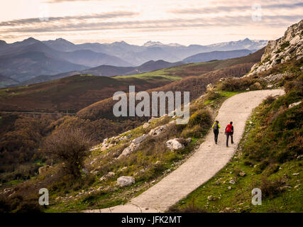 Women and Man on a hiking tour in the Picos de Europa near Potes. Cantabria, Northern Spain - Stock Photo