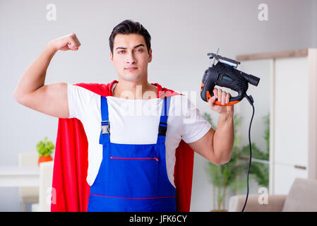 Superhero repairman with tools in repair concept - Stock Photo