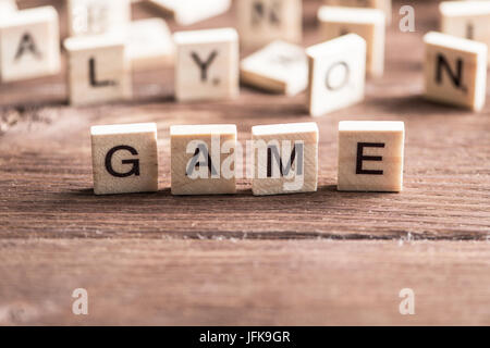 Alphabet wooden letters on wood collected to word game - Stock Photo
