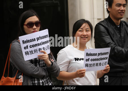 London, UK. 01st July, 2017. LONDON, UK - July 1, 2017: Umbrella movement supporters hold placards demaning the - Stock Photo