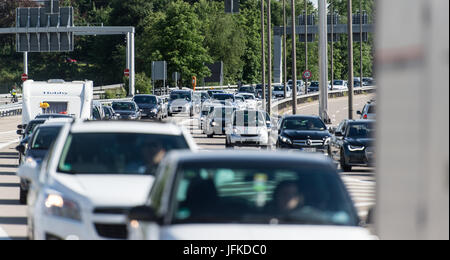 Vehicles lined up at the border crossing between Germany and Switzerland at Weil am Rhein, Germany, 29 June 2017. - Stock Photo
