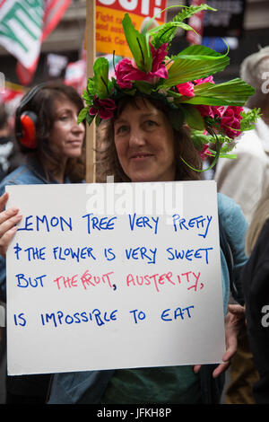 London, UK. 1st July, 2017. A woman holds a sign on the Not One More Day national demonstration organised by the - Stock Photo