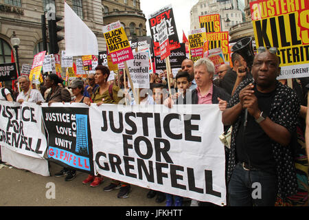 London, UK - 1 July 2017 - Demonstrators holding 'Justice for Grenfell' seen on Regent Street during a demonstration - Stock Photo