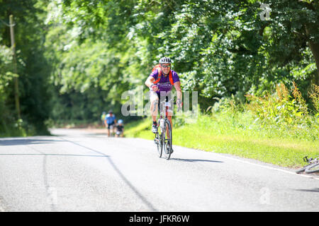 Elmdon, Essex. UK. 2nd July, 2017. Cyclists on the London to Cambridge cycle ride pass through the Essex village - Stock Photo