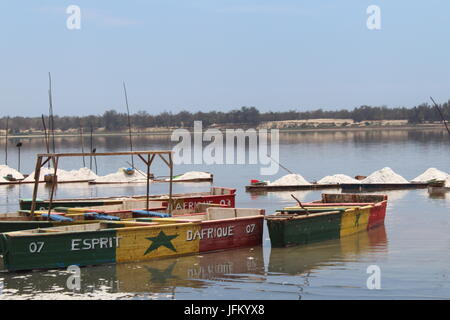 Boats painted with the colors of the Senegalese flag floating on Lake Retba, Pink Lake, Lac Rose, outside Dakar, - Stock Photo