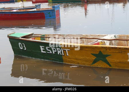 Salt gathering boat painted in the senegalese colors, Lake Retba Pink Lake Lac Rose, Dakar Senegal Africa - Stock Photo
