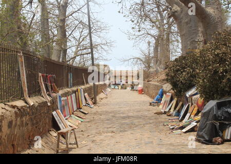 Paintings for sale on Goree Island in Senegal - Stock Photo