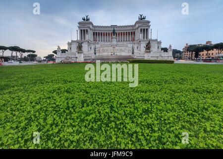 Dusk lights on the green gardens surrounding The Altare della Patria also known as Vittoriano Rome Lazio Italy Europe - Stock Photo