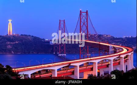 The 25 de Abril Bridge and Christ the King monument, Lisbon, Portugal - Stock Photo