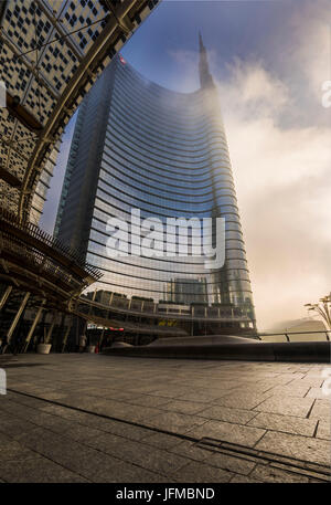 Gae Aulenti Sqaure, Milan, Lombardy, Italy, The Unicredit Tower in the morning fog, - Stock Photo