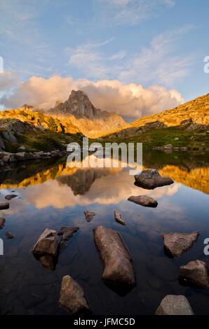 Europe, Italy, Trentino Alto Adige, Rolle pass, Cimon della Pala reflected in the lakes of Cavallazza at sunset, - Stock Photo